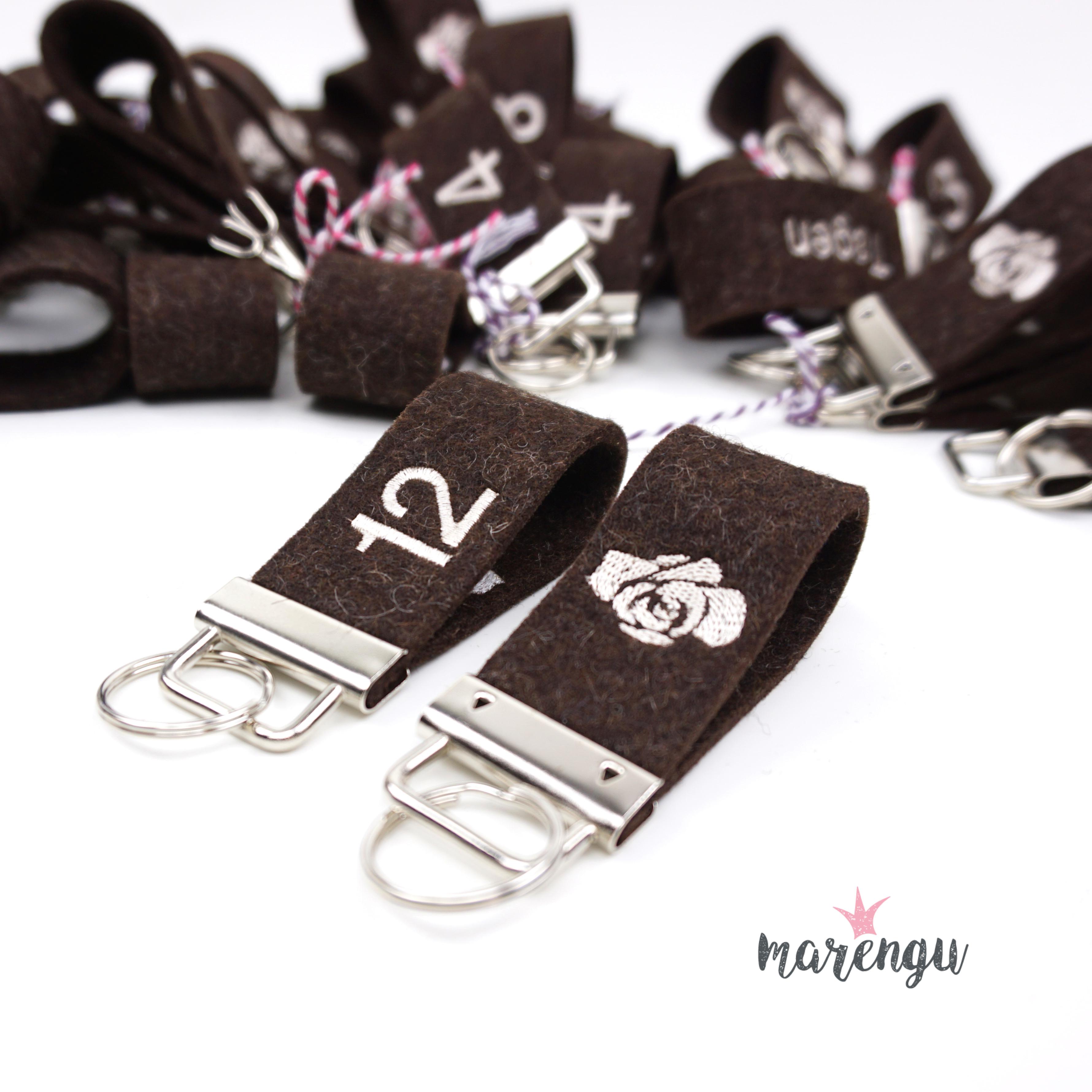 Rose Bio-Restaurant & Hotel - Bestickte Schlüsselanhänger aus Wollfilz mit Logo und Zimmernummer - marengu